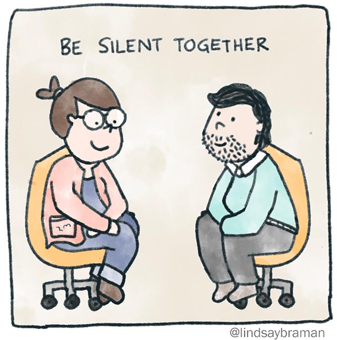 When you don't know what to say in therapy, you be silent together. Image of two people in chairs, facing one another.