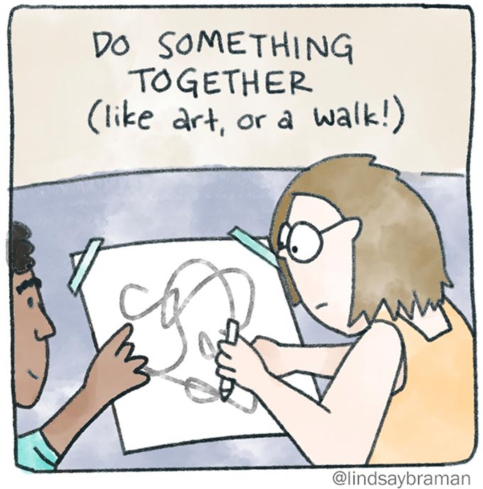 When you don't know what to say in therapy, you can do something together. Image of two people sitting at a drawing table. One person is drawing on a piece of paper with a marker. The other is pointing at the drawing.