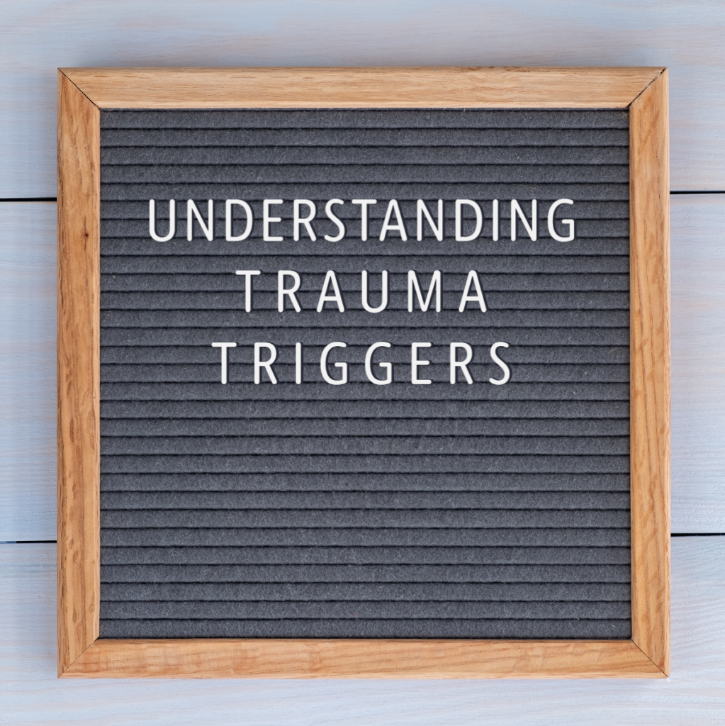 A letterboard states: Understanding trauma triggers.